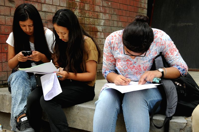 Students fill-up forms for admissions in colleges affiliated to Delhi University in New Delhi on July 1, 2014.