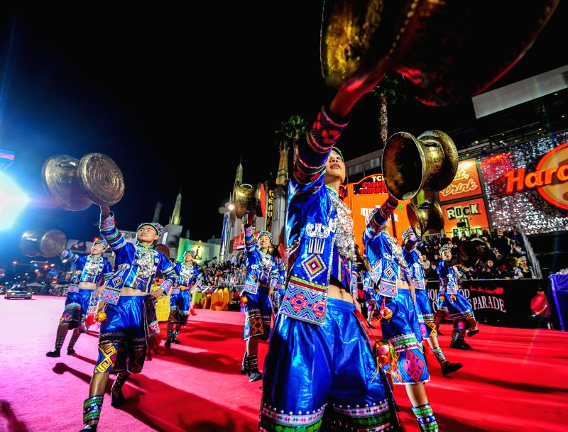 Students from Guangxi University of Finance and Economics of China perform during the 84th Hollywood Christmas Parade in Los Angeles, the United States, Nov. ...