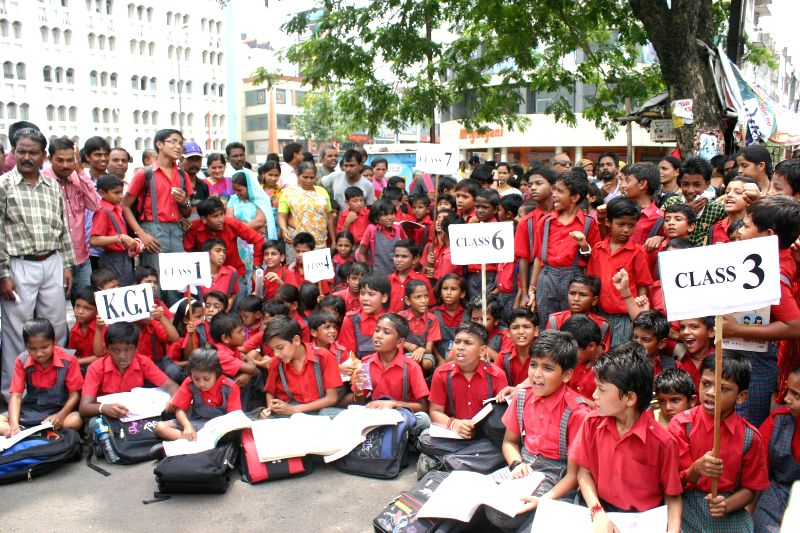 Students of a Bhopal primary school demonstrate to press for re-opening of their school which has been closed down by the district administration on Aug 22, 2014.