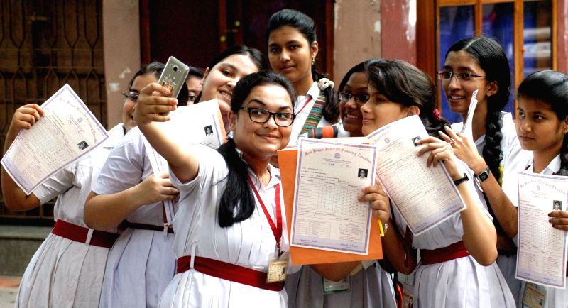 Students of a Kolkata school celebrate after declaration of West Bengal Board of Secondary Education (WBBSE) results in Kolkata, on May 10, 2016.