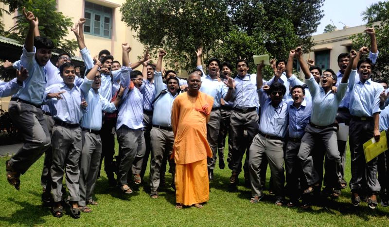 Students of a Kolkata school celebrate after declaration of results of West Bengal Council of Higher Secondary Exam on May 16, 2016.