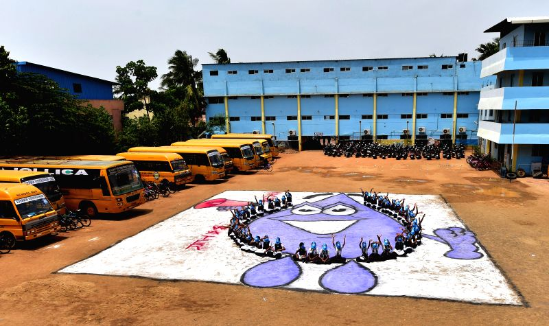 Students of a private school staged a concept drawing on harvesting of rainwater in a space of 5,000 square foot at the campus in Chennai on June 21, 2014.