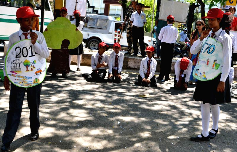 Students of Blue Bell School, Hatigaon stage a street play on `Save Trees Save Environment` in Guwahati  on Aug 29, 2014.