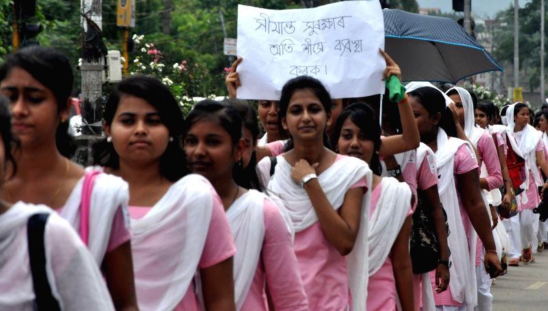 Students of Commerce College take out a rally to condemn lathi-charge on protestors demonstrating in Golaghat of Assam, in Guwahati on Aug 22, 2014.