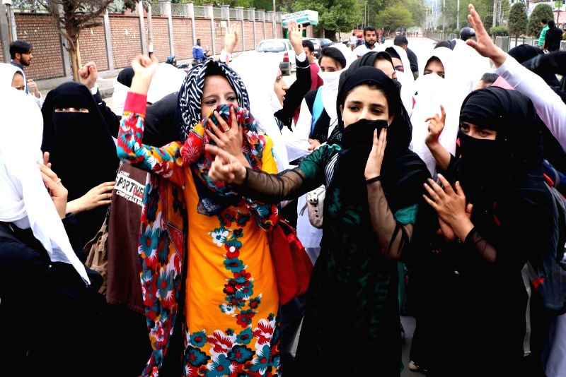 Students of Government College for Women stage a demonstration in Srinagar on April 245, 2017.