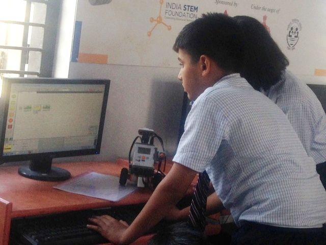 Students of Jawahar Navodaya Vidyalaya while programming their robot