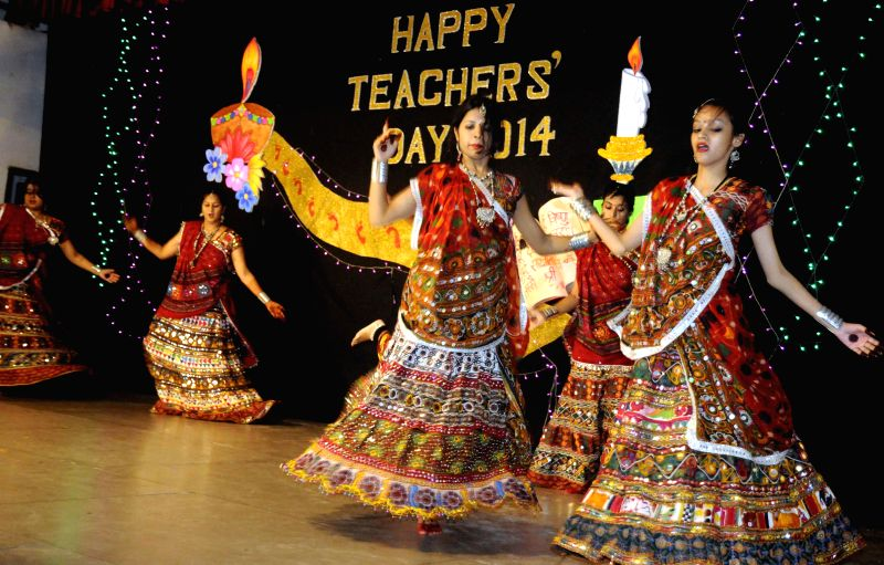 Students of Patna Women's College perform during a programme organised to celebrate Teachers' Day celebrations in Patna on Sept 1, 2014.