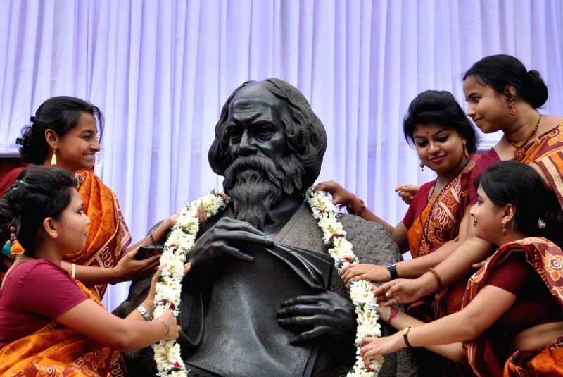 Students of Rabindra Bharati University celebrate Nobel laureate Rabindranath Tagore's 155th birth anniversary on May 7, 2016.