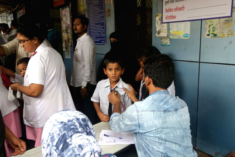 Students of Sanjay Nagar BMC School No. 2 who fell ill following a medical dose administered at the school being treated at a Mumbai Hospital on Aug 10, 2018. A 12-year-old girl student of a ...