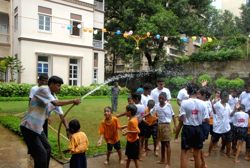 Students of the Victoria Memorial School For The Blind celebrating dahi handi in Mumbai on August 16, 2014.