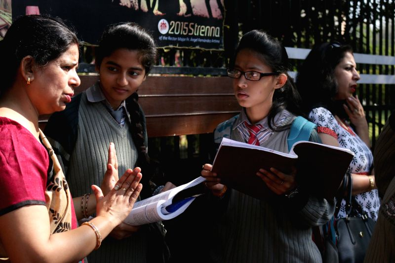 Students outside an examination centre ahead of their board examinations in New Delhi on March 20, 2015.