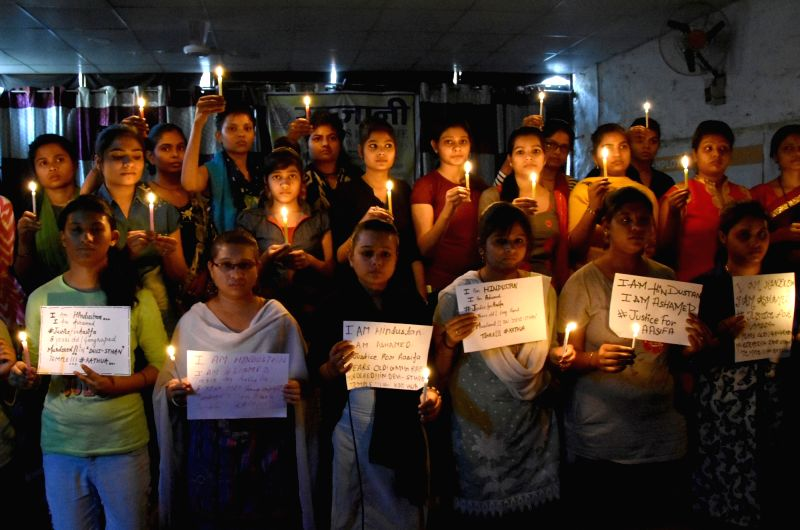 Students participate in a candle light vigil organised to express solidarity with Kathua rape and murder victim, in Mathura on April 14, 2018.