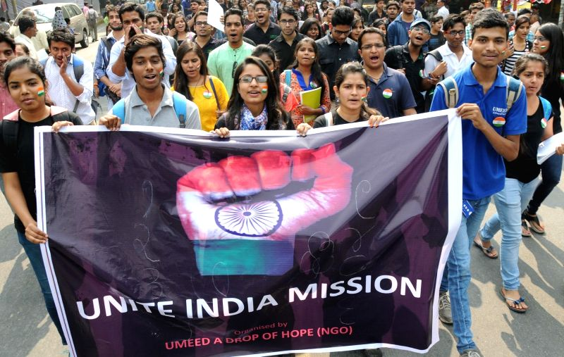 Students participate in a march to press for United India  in New Delhi, on Nov 1, 2015.