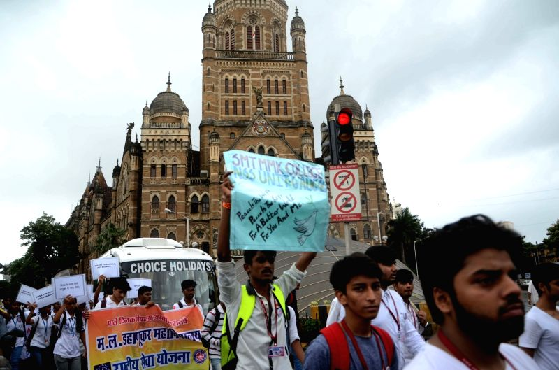 Students participate in a rally on the anniversary of Hiroshima and Nagasaki atomic bombings in Mumbai on Aug. 6, 2016.