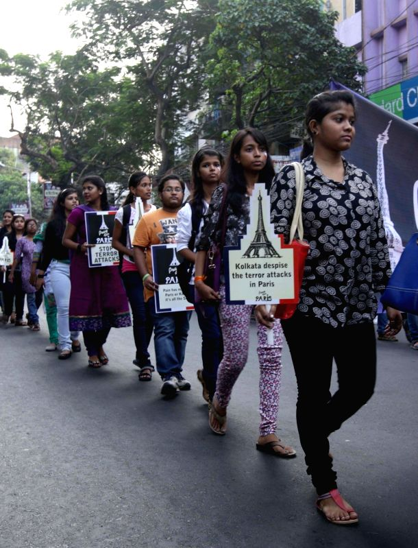 Students participate in a rally organised to show solidarity with the victims of 13/11 Paris blasts in Kolkata on Nov 18, 2015.