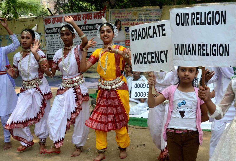 Students participate in an awareness programme organised by International Indecency Prevention Movement for world peace and unity at Jantar Mantar in New Delhi on April 20, 2014.