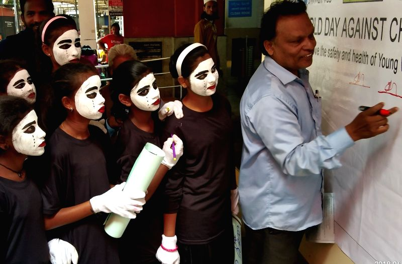 Students participate in an awareness programme organised on World Day Against Child Labour at Bengaluru City Railway Station on June 12, 2018.