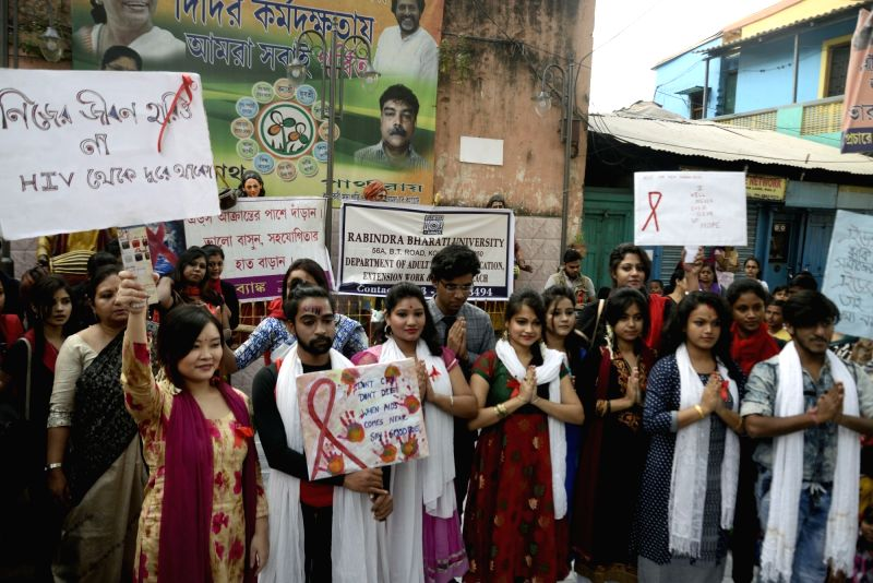 Students participate in an awareness rally World AIDS Day in Kolkata, on Dec 1, 2017.