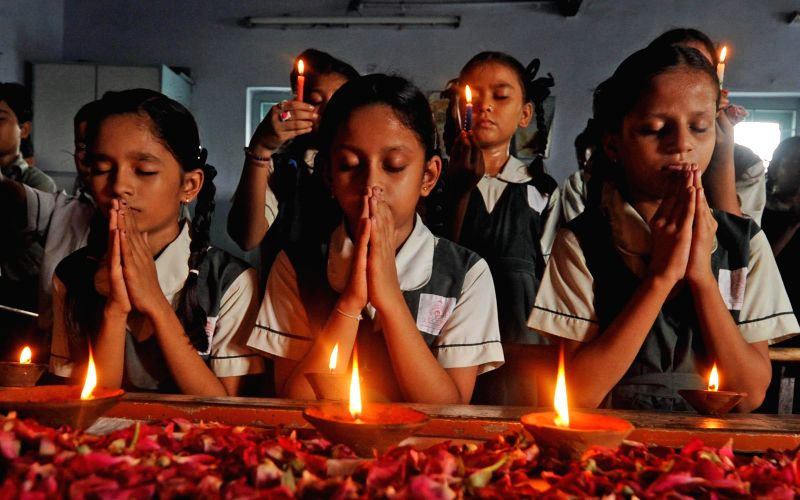 Students paying tribute to the victims of Ahmedabad serial bomb blast on its sixth anniversary at a school in Ahmedabad on July 26, 2014.