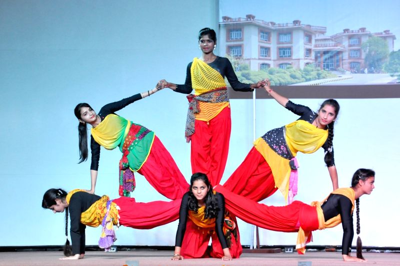 Students perform during a cultural programme organised at a Haridwar University.