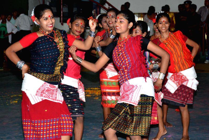 Students perform on the 31st Abhiruchi Sports Day celebrations organised on the birthday of Bhogeswar Barua in Guwahati on Sept 3, 2014.