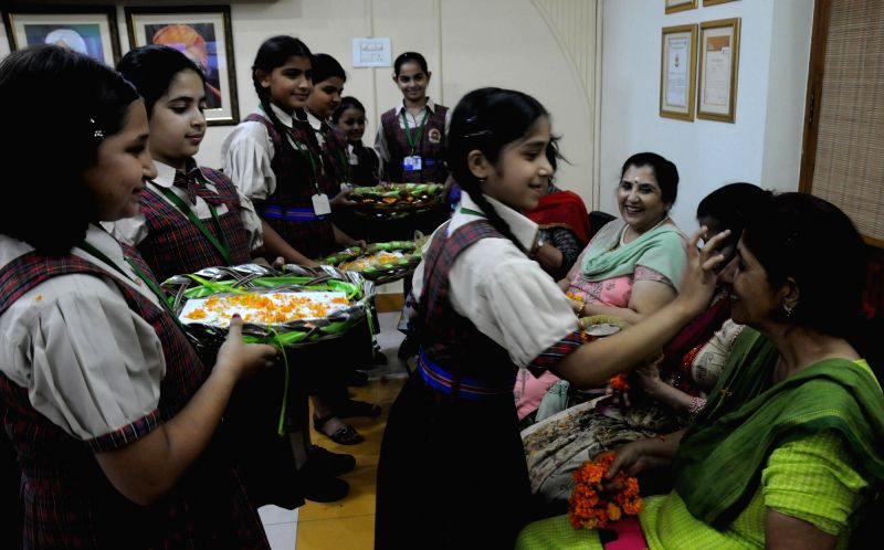 Students perform rituals in front of their teachers on the occasion of Guru Purnima in Amritsar on July 19, 2016.