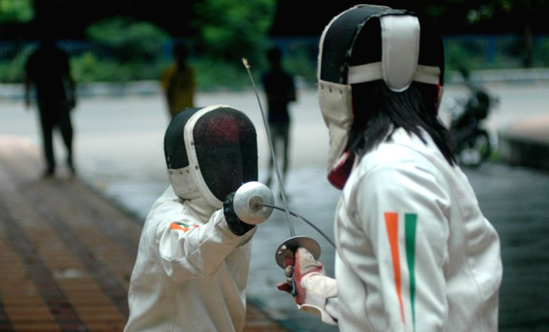 Students practice fencing in Kolkata, on Aug 7, 2016.