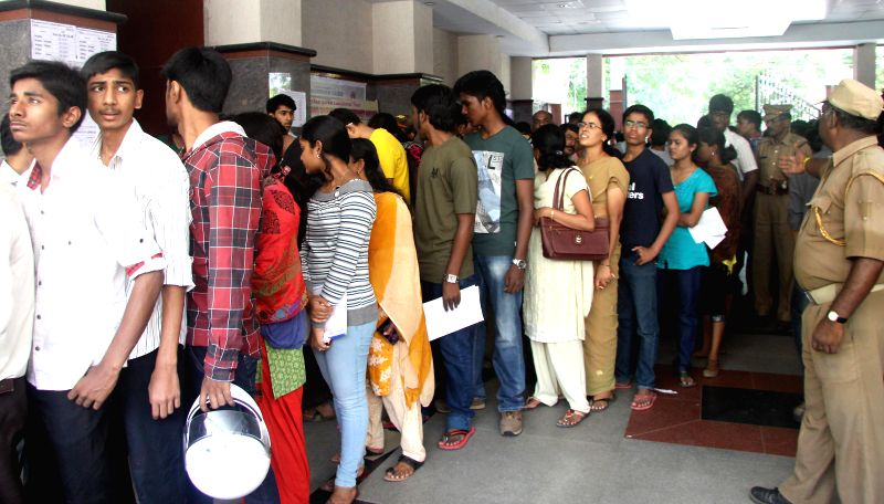 Students queue-up at Seshadripuram College for admissions in Bangalore on May 13, 2014.