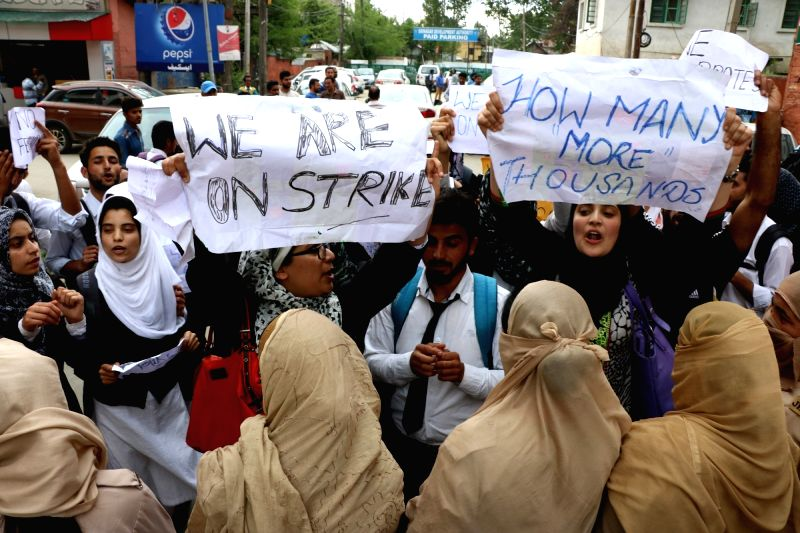Students stage a demonstration against Kashmir University authorities in Srinagar, on May 30, 2016.