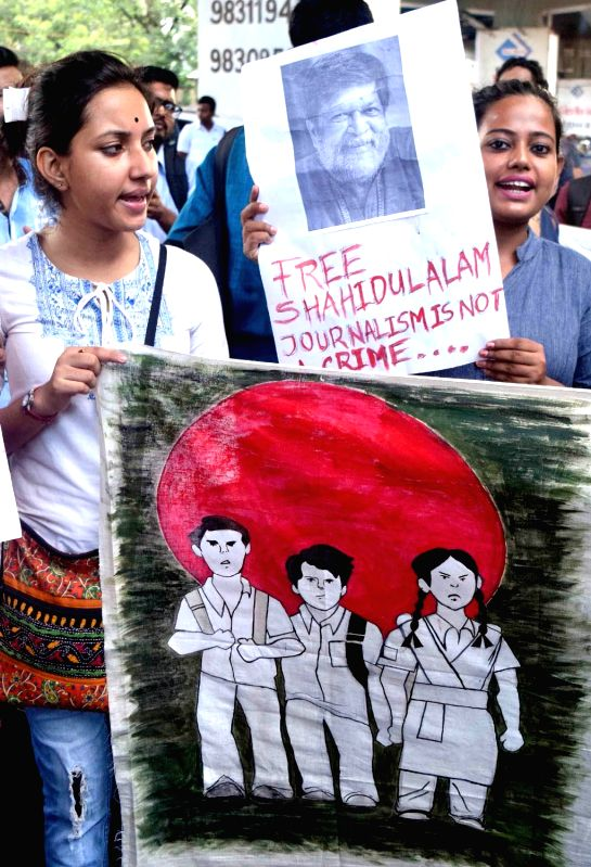 Students stage a demonstration against the detention of eminent Bangladeshi photographer and educator Shahidul Alam in Dhaka under the provisions of the Information and Communication ...