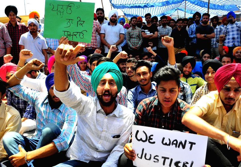 Students stage a sit-in demonstration to demand justice for the Khalsa College student Harpreet Singh who had committed suicide last night, in Amritsar on April 27. 2017. - Harpreet Singh