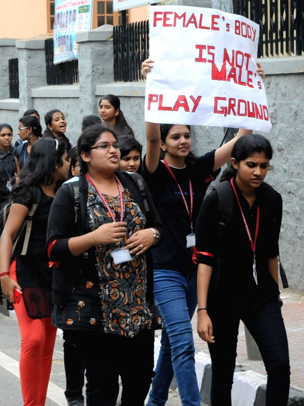 Students take part in protest rally over the heinous crimes against Women and Children, demanding stringent punishment to the rapists, in Bangalore on July 26, 2014.