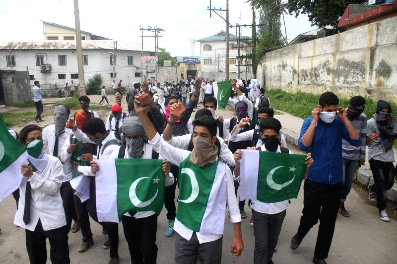 Students waive Pakistan flags during a protest in Srinagar on May 22, 2017.