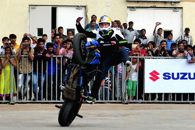Stunt rider Aras Gibieza displays his skills at a stunt biking show, in Bengaluru on May 12, 2016.