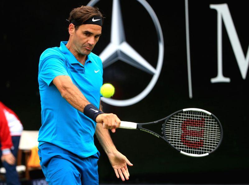STUTTGART, June 14, 2018 - Roger Federer of Switzerland returns a shot during the singles second round match against Mischa Zverev of Germany at the ATP Mercedes Cup tennis tournament in Stuttgart, ...