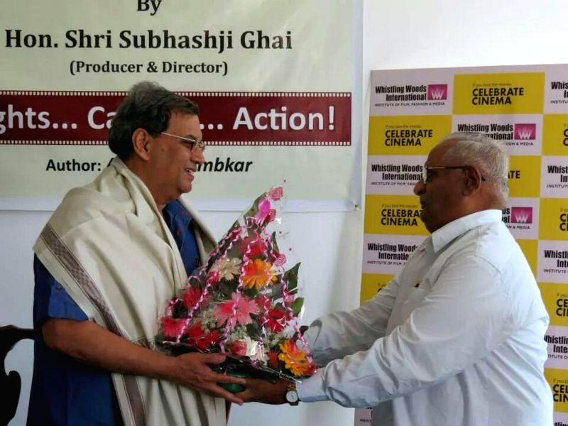 Subhash Ghai and Ashok Ujlambkar  at the launch of renowned author Ashok Ujlambkar's book `Light Camera Action` at Whistling Woods International in Mumbai on May 18, 2014.