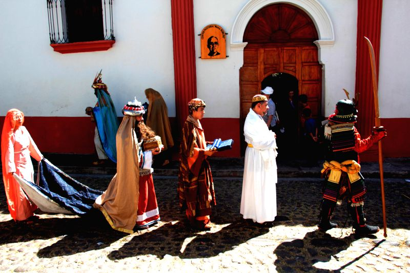 People characterized as the Three Wise Men, namely Melchior, Caspar and Balthazar, pose before a pilgrimage on the streets, for the celebration of Jan. 6, the Day .