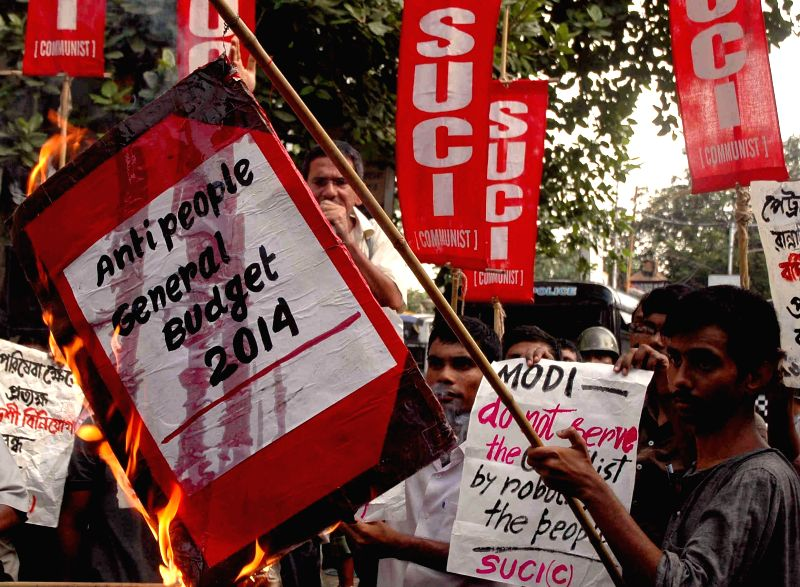 SUCI activists demonstrate against General Budget 2014-15 in Kolkata on July 10, 2014.