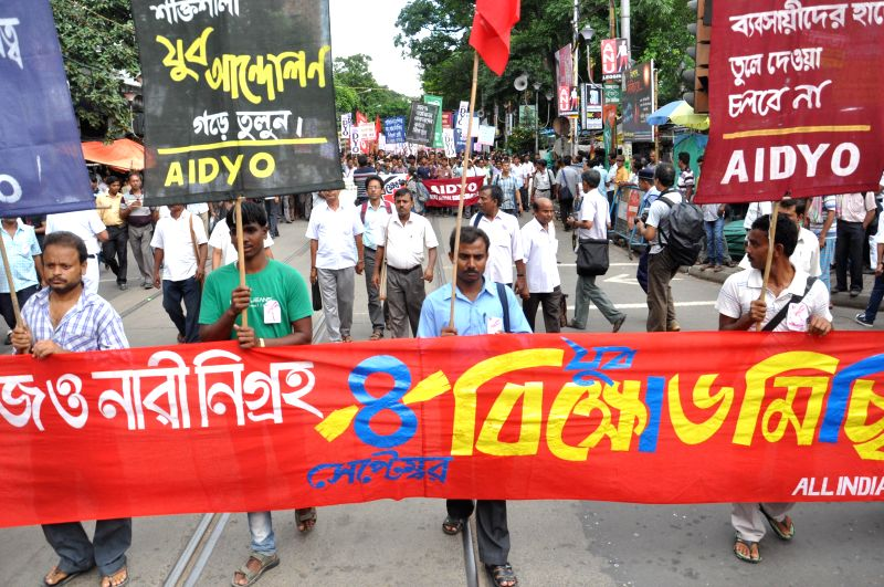 SUCI activists participate in a protest rally against West Bengal Government in Kolkata on Sept 4, 2014.