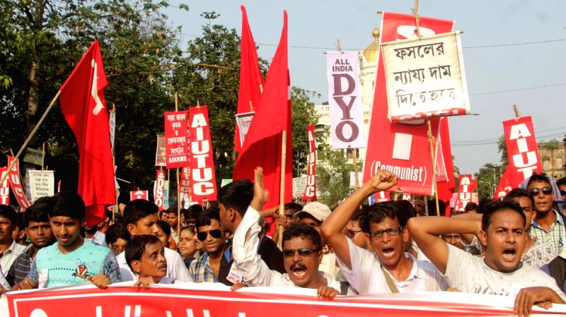 SUCI activists stage a protest against the West Bengal and the Union Governments in Kolkata, on May 24, 2017.