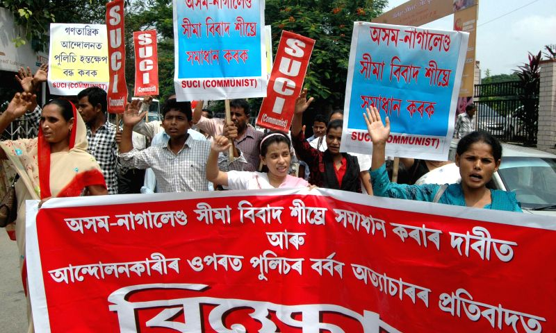 SUCI (C) take out a rally to press for securing all the boundaries of Assam in Guwahati on Aug 22, 2014. Tension has gripped the Assam-Nagaland border since the night of 12th August when suspected ...