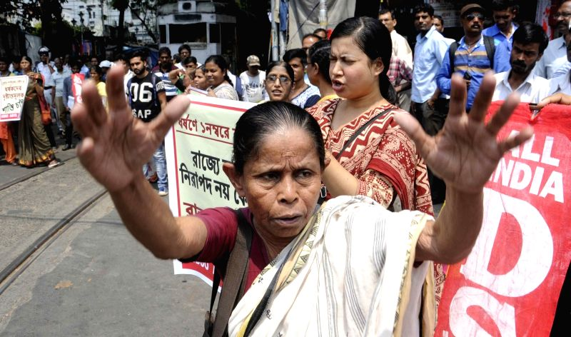 SUCI workers stage a demonstration against rape of a 25 year old woman in Kolkata's Salt Lake; on May 31, 2016.