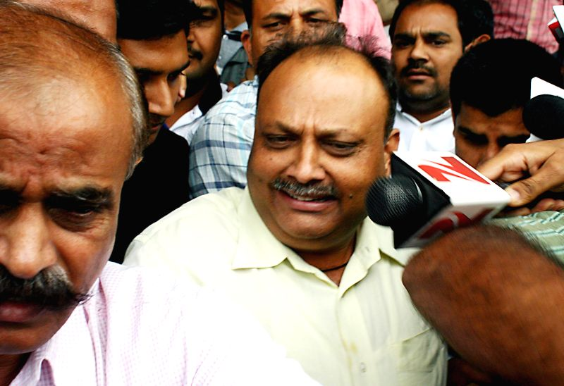 Sudhir Sharma, a mining baron and wanted in Madhya Pradesh Professional Examination Board (MPPEB) scam arrives to surrender at a Bhopal Court on July 25, 2014.