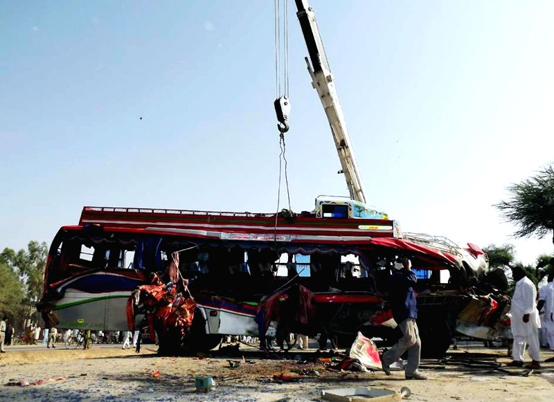 SUKKAR (PAKISTAN), April 20, 2014 Pakistani rescuers work at the accident site in southern Pakistan's Sukkur on April 20, 2014. Death toll of Sunday morning's bus-trailer accident in ...