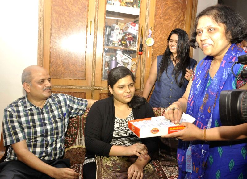 Sukriti Gupta,topped the class 12 examination of the Central Board of Secondary Education (CBSE), securing 99.4 percent marks celebrates with her parents in New Delhi on May 21, 2016. - Sukriti Gupta