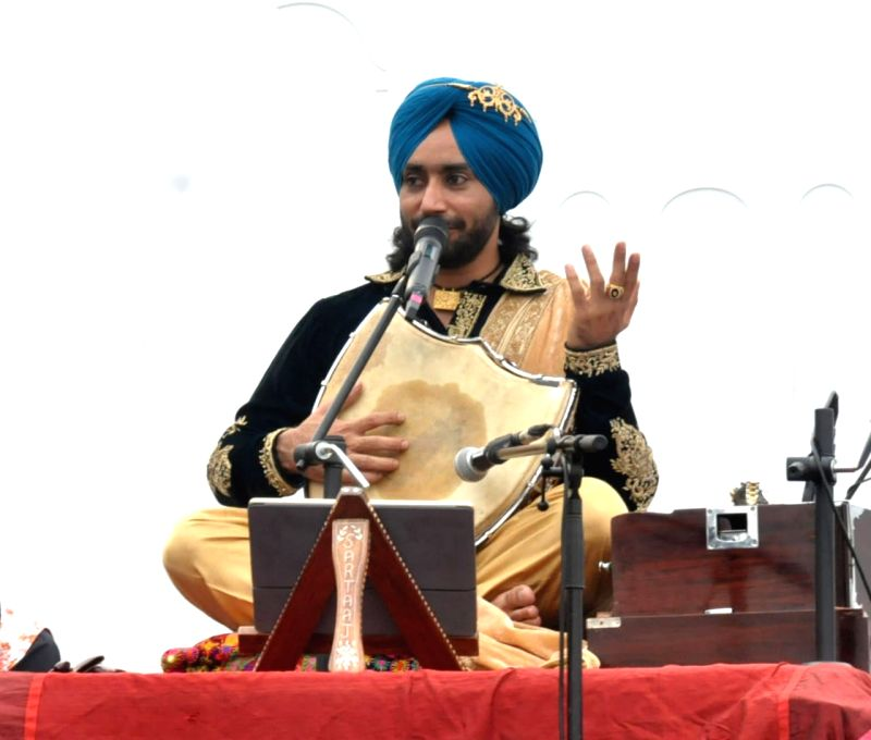Sultanpur Lodhi: Sufi singer Satinder Sartaj pays a musical tribute to Guru Nanak Dev on his 550th birth anniversary during a programme organised by the Punjab Government in Punjab's Sultanpur Lodhi on Nov 12, 2019. (Photo: IANS)