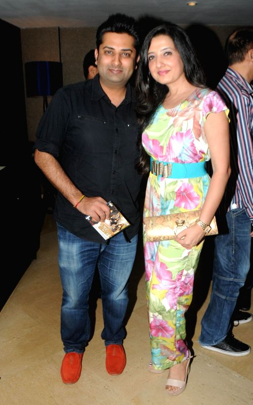 Sumeet Tappoo with Amy Billimoria during the launch of Dilbagh Singh`s music album The Victorian Secrets in Mumbai on July 21, 2014. - Dilbagh Singh