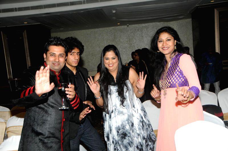 Sumeet Tappoo with Aryaman Jalota Richa Sharma and Sujata Majumdar during Anup Jalota`s 56th birthday celebrations in Mumbai on July 29, 2014.