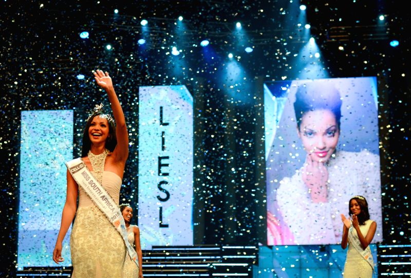 The First Prize Winner Liesl Laurie waves to the spectators during the Miss South Africa 2015 Pageant and Celebration in Sun City, South Africa, on March 29, ...