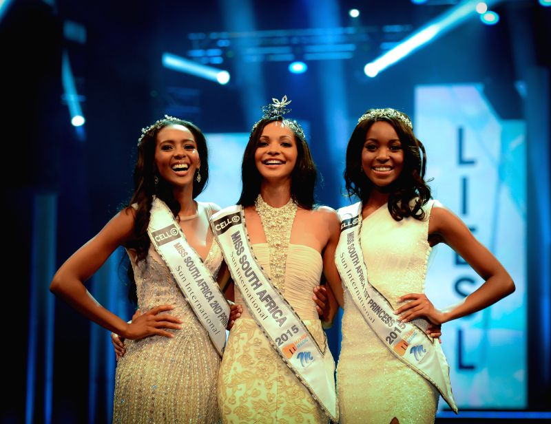 The First Prize Winner Liesl Laurie (C), the First Princess Refilwe Mthimunye (R) and the Second Princess Ntsiki Mkhizeduring pose for photos during the Miss ...